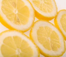 Free Slices Of Lemon Isolated On White Background Royalty Free Stock Photography - 7718337