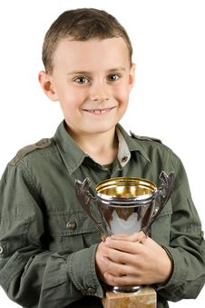 Free Smiling Champion With His Trophy Stock Photography - 7718792