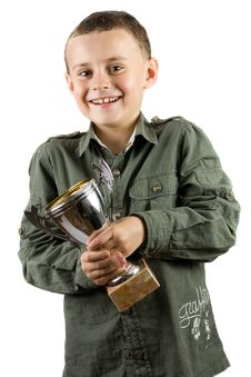 Free Smiling Champion With His Trophy Stock Photography - 7718872