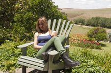 Woman Sitting And Looking At The Field Royalty Free Stock Photos