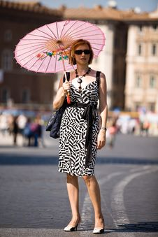 Free Lovely Woman With Pink Sunshade In Rome Town Stock Images - 7728274