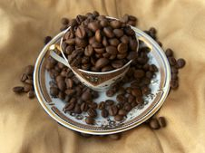 Free Cup Full Of Coffee Grains. Royalty Free Stock Images - 7729219