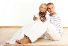 Free Happy Couple With A Puppy Stock Photo - 7730280
