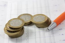 Free Coins On A Chart Stock Photo - 7731020