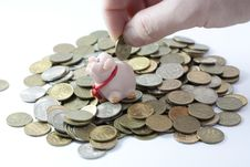 Free Businessman Loading A Piggy Bank Stock Images - 7731214