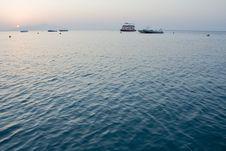 Free Sunrise And  Few Boats Royalty Free Stock Image - 7731236