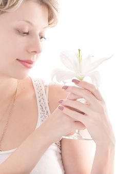 Free Portrait Of Attractive Blond Girl Smelling Lily Royalty Free Stock Photo - 7734405