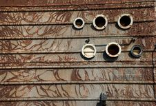 Free Rusty Surface With Round Apertures Royalty Free Stock Photography - 7739627