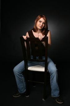 Free Pretty Teenage Girl Sitting On A Chair Stock Photos - 7741123