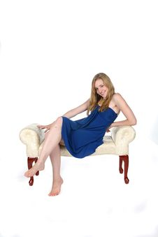 Sexy Woman In Short Blue Dress On Bench Royalty Free Stock Image