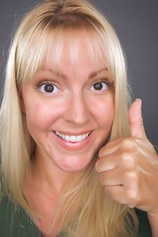 Beautiful Woman With A Thumbs Up Royalty Free Stock Photos
