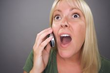 Free Stunned Blond Woman Using Cell Phone Stock Photos - 7746323