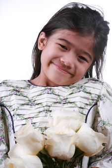 Free Asian Child Holding White Roses Stock Photography - 7746402