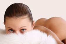 Attractive Woman Hiding Behind A Fur Royalty Free Stock Image