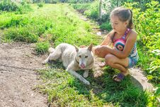 Free Girl Playing With A Dog Royalty Free Stock Image - 77446256