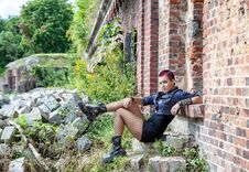 Free Punk Girl Sitting On The Porch Of An Old Castle Royalty Free Stock Photo - 77446305