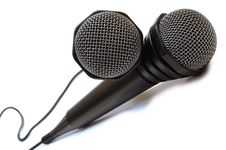 Two Black Wired Karaoke Microphones. Royalty Free Stock Image