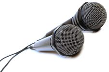 Free Two Black Wired Karaoke Microphones. Royalty Free Stock Photos - 7751588