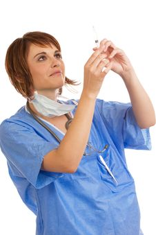 Free Female Doctor Inspecting Filled Syringe Stock Images - 7753864