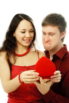 Free Young Couple Opening A Present Royalty Free Stock Photography - 7755687