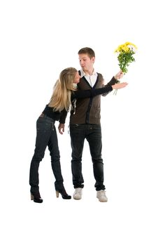 Enamoured Guy And The Girl With A Bouquet Royalty Free Stock Photography