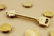 Free Golden Key And Coins Stock Image - 7759101