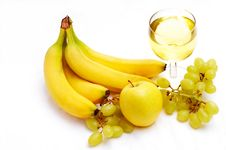 Yellow Fruits And White Wine Royalty Free Stock Photos