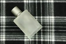 Perfume Bottle On Check Pattern Royalty Free Stock Images