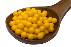 Yellow Pills On Spoon Royalty Free Stock Images