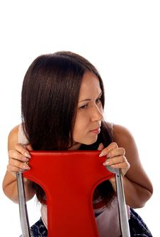 Young Woman Is Sitting On The Chair Royalty Free Stock Photos