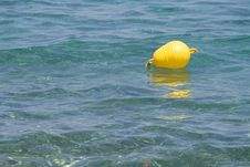 Free Yellow Buoy On Clear Blue Sea (room For Text) Stock Photography - 7765172