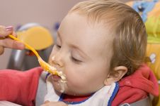 Free Little Baby Girl Eating In A High Chair Royalty Free Stock Photography - 7765737