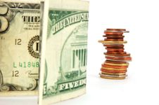 Paper Money And Column Of Coins Stock Images