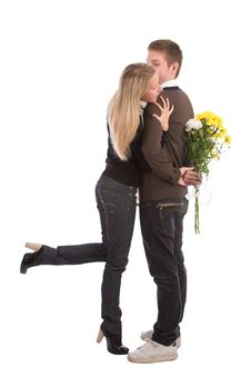 Enamoured Guy And The Girl With A Bouquet Royalty Free Stock Photo
