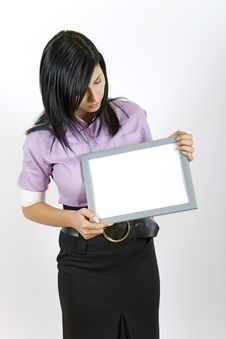 Free Attractive Businesswoman Looking At A Blank Frame Royalty Free Stock Photo - 7769765