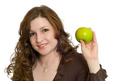 Free Woman Smiling Holding Healthy Fresh Green Apple Royalty Free Stock Photo - 7770145