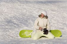 Free Woman With Snowboard Sitting Royalty Free Stock Photography - 7771817