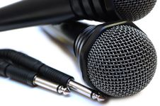 Two Black Wired Karaoke Microphones. Stock Image