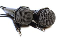 Two Black Wired Karaoke Microphones. Royalty Free Stock Images