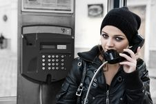 The Young Girl In Telephone Booth Stock Photos