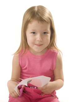 Pretty Small Girl Is Cutting Paper Heart Shape Stock Photo