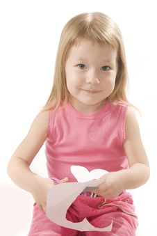 Pretty Small Girl Is Cutting Paper Heart Shape Stock Photography