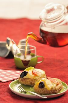 Tasty Cake With Fresh Fruit And  Tea Royalty Free Stock Images
