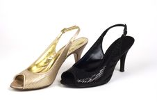 Free Gold And Black Women S High-Heel Shoes Royalty Free Stock Photography - 7785997