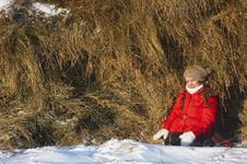 Free Beautiful Girl In The Winter Sits About Stacks Of Stock Images - 7787974