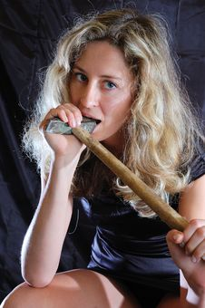 Free Girl Biting A Hammer Stock Photography - 7789842