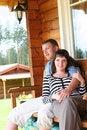 Free Couple Relaxing On Verandah Stock Image - 7791181