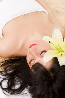 Free Spa Brunette With Lily Stock Photography - 7793262