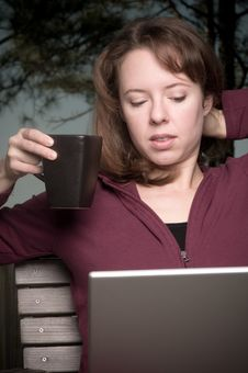 Young Woman With Coffee And Laptop Stock Images