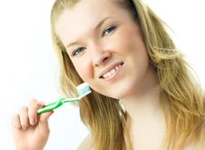 Free Young Blond Woman Brushing Her Teeth Stock Photos - 7799533